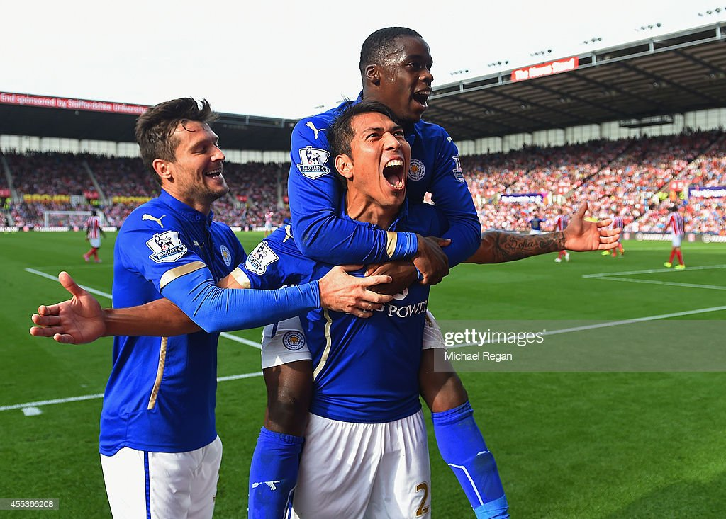 Leonardo Ulloa of Leicester City celebrates scoring the first goal with David Nugent and Jeffrey Schlupp of Leicester City during the Barclays Premier League match between Stoke City and Leicester City at Britannia Stadium on September 13, 2014 in Stoke on Trent, England.