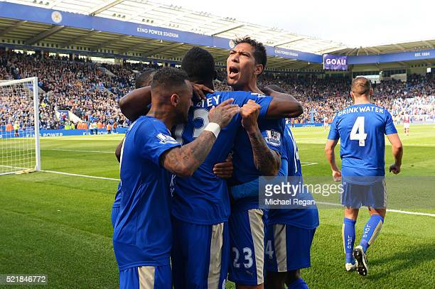 Leonardo Ulloa of Leicester City celebrates with team mates after scoring his team's second goal of the game from the penalty spot during the...