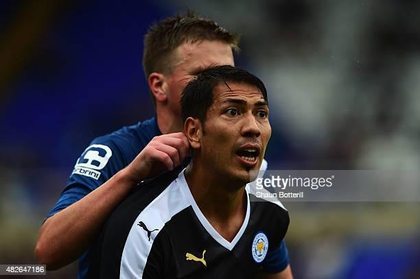 Leonardo Ulloa of Leicester City has his ear pulled by Stephen Gleeson of Birmingham City during the PreSeason Friendly match between Birmingham City...