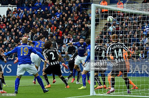 Leonardo Ulloa of Leicester City heads the opening goal during the Barclays Premier League match between Leicester City and Newcastle United at The...