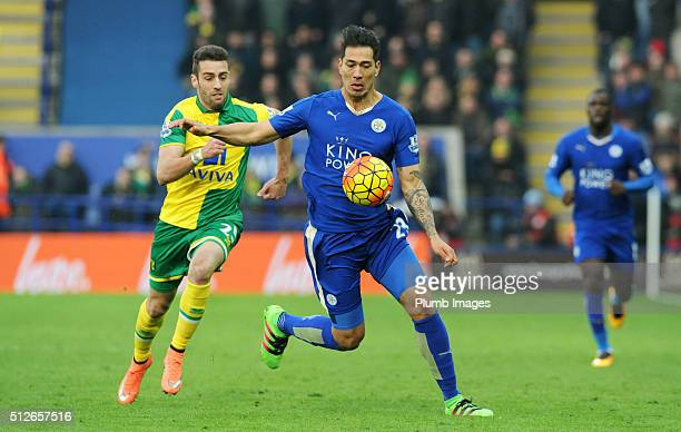 Leonardo Ulloa of Leicester City in action with Ivo Pinto of Norwich City during the Barclays Premier League match between Leicester City and Norwich...
