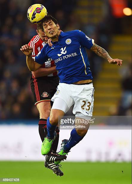 Leonardo Ulloa of Leicester City is challenged by Lee Cattermole of Sunderland during the Barclays Premier League match between Leicester City and...