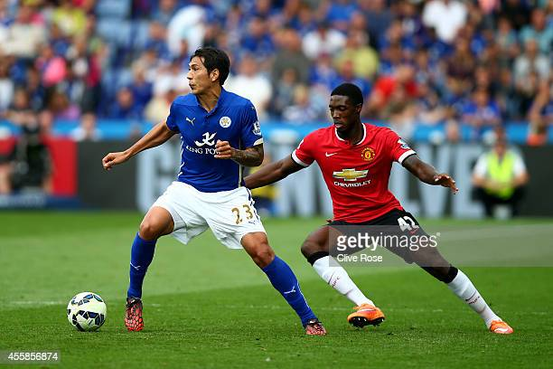 Leonardo Ulloa of Leicester City is closed down by Tyler Blackett of Manchester United during the Barclays Premier League match between Leicester...