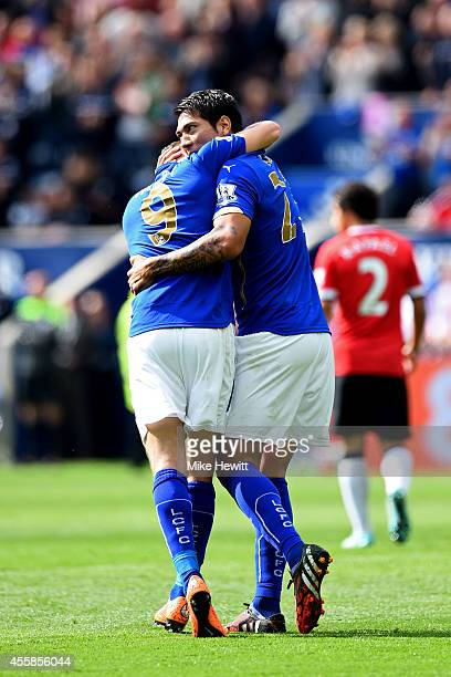 Leonardo Ulloa of Leicester City is congratulated by teammate Jamie Vardy of Leicester City after scoring his team's opening goal during the Barclays...