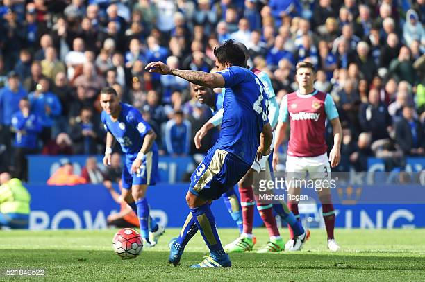 Leonardo Ulloa of Leicester City scores his team's second goal of the game from the penalty spot during the Barclays Premier League match between...