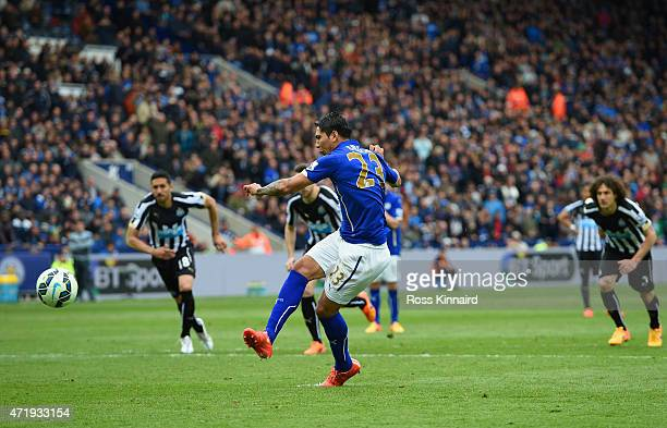 Leonardo Ulloa of Leicester City scores his team's third goal from the penalty spot during the Barclays Premier League match between Leicester City...