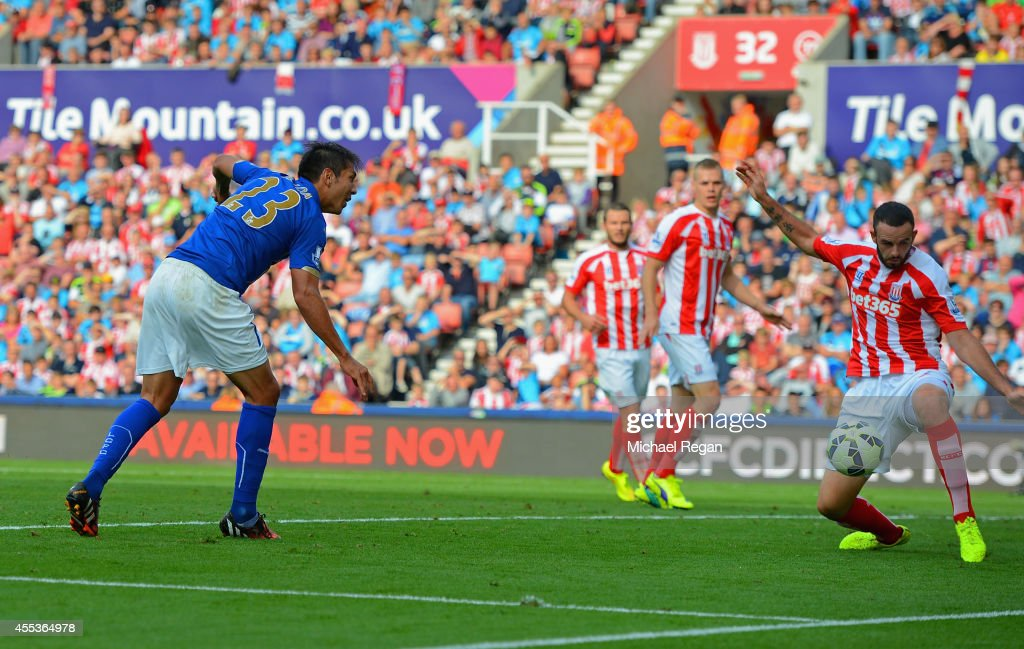 Leonardo Ulloa of Leicester City scores the opening goal during the Barclays Premier League match between Stoke City and Leicester City at Britannia Stadium on September 13, 2014 in Stoke on Trent, England.