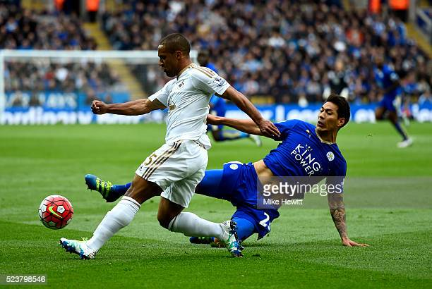 Leonardo Ulloa of Leicester City stretches to tackle Wayne Routledge of Swansea City during the Barclays Premier League match between Leicester City...