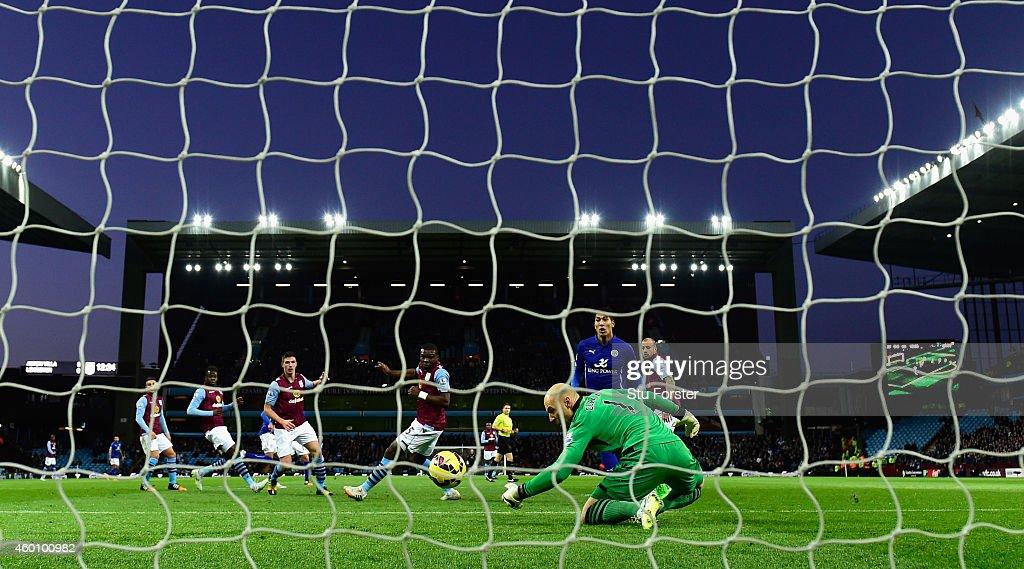 Leonardo Ulloa of Leicester scores the first goal past Villa goalkeeper Brad Guzan during the Barclays Premier League match between Aston Villa and Leicester City at Villa Park on December 7, 2014 in Birmingham, England.