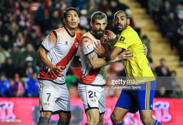 Leonardo Ulloa, player of Rayo Vallecano from Argentina, Esteban Saveljich, player of Rayo Vallecano from Montenegro, and Rafael Jimenez Jarque...