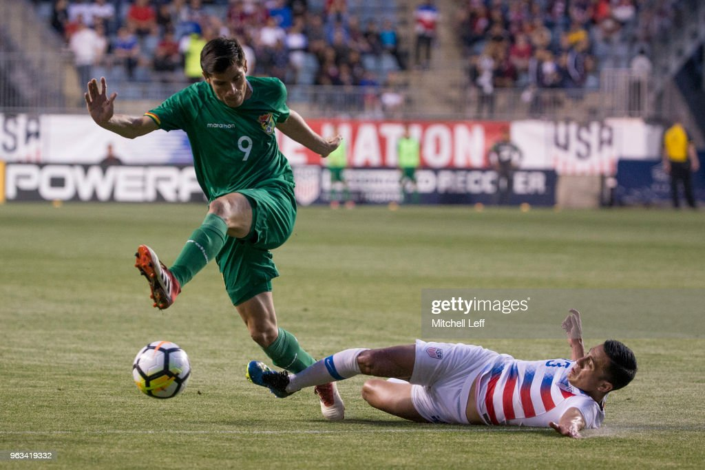 Leonardo Vaca #9 of Bolivia controls the ball as Rubio Rubin #23 of United States slides into him in the second half during the friendly soccer match at Talen Energy Stadium on May 28, 2018 in Chester, Pennsylvania. The United States defeated Bolivia 3-0.