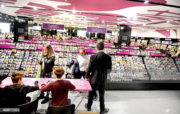 Leondre Devries and Charlie Lenehan of Bars Melody meet fans and sign copies of their new single 'Stay Strong' at HMV on April 7 2015 in Liverpool...