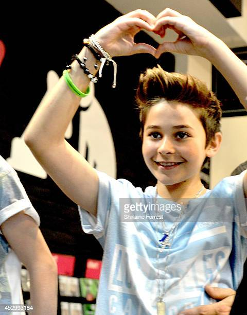 Leondre Devries of Bars and Melody Britain's Got Talent finalists sign copies of their debut single 'Hopeful' at HMV Manchester on July 31 2014 in...