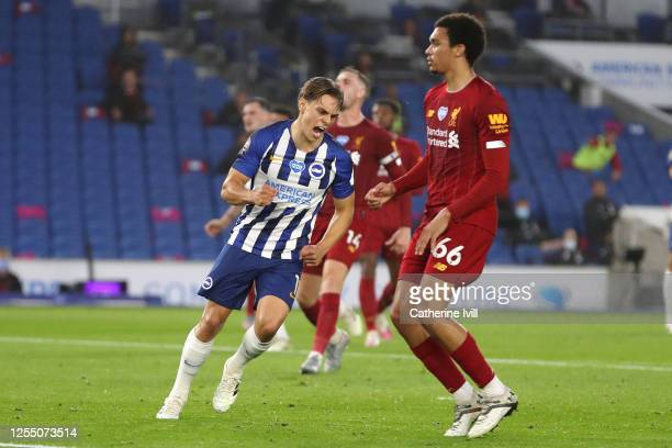 Leondro Trossard of Brighton and Hove Albion celebrates after he scores his sides first goal during the Premier League match between Brighton Hove...