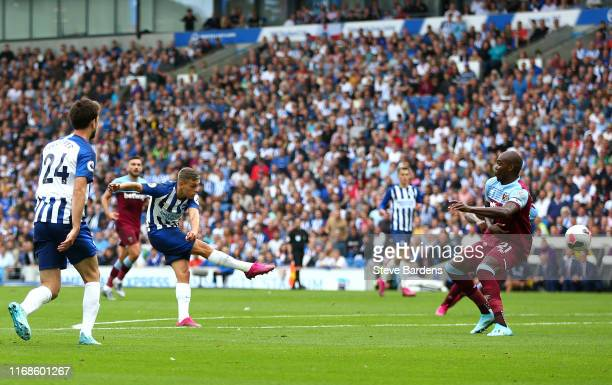 Leondro Trossard of Brighton and Hove Albion scores his team's first goal during the Premier League match between Brighton & Hove Albion and West Ham...