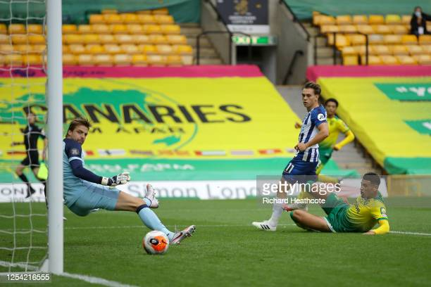 Leondro Trossard of Brighton and Hove Albion scores his team's first goal past Tim Krul of Norwich City during the Premier League match between...
