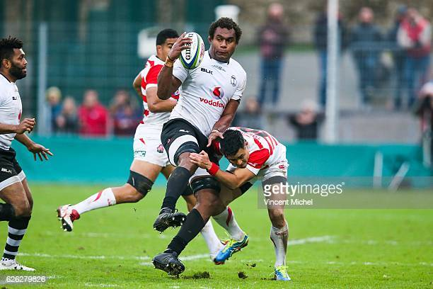 Leone Nakarawa of Fiji and Yu Tamura of Japan during the Test match between Fiji and Japan at Stade de la Rabine on November 26 2016 in Vannes France