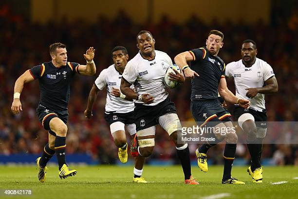 Leone Nakarawa of Fiji is challenged by Alex Cuthbert and Gareth Davies of Wales during the 2015 Rugby World Cup Pool A match between Wales and Fiji...