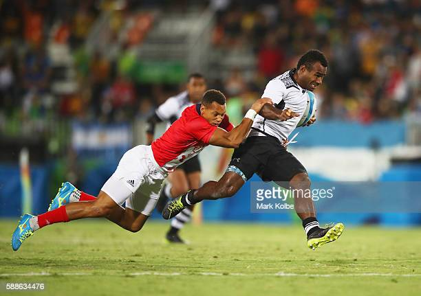 Leone Nakarawa of Fiji is tackled by Dan Norton of Great Britain during the Men's Rugby Sevens Gold medal final match between Fiji and Great Britain...