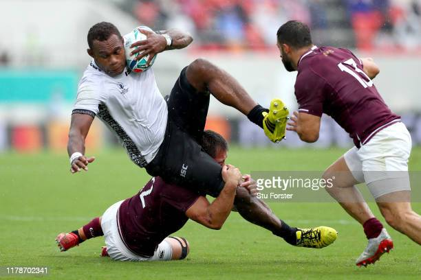 Leone Nakarawa of Fiji is tackled by Merab Sharikadze of Georgia during the Rugby World Cup 2019 Group D game between Georgia and Fiji at Hanazono...