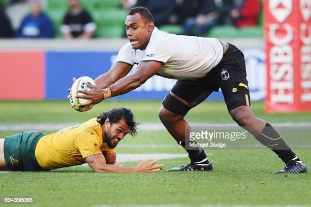 Leone Nakarawa of Fiji juggles the ball over Karmichael Hunt of the Wallabies during the International Test match between the Australian Wallabies...