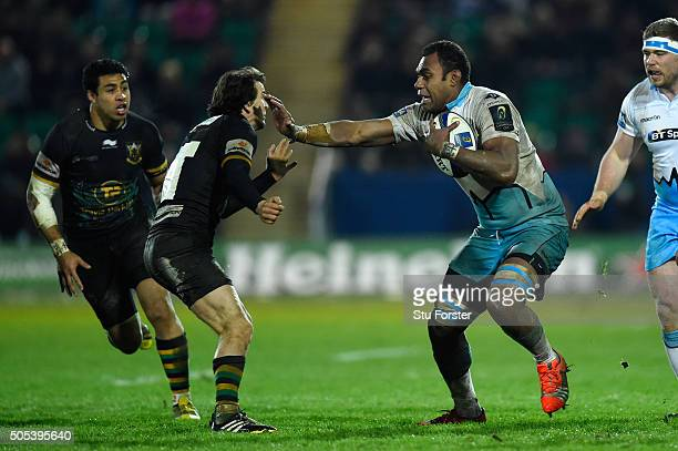 Leone Nakarawa of Glasgow Warriors hands off Lee Dickson of Northampton Saints during the European Rugby Champions Cup pool three match between...