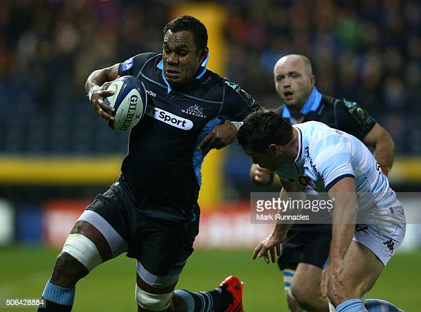 Leone Nakarawa of Glasgow Warriors is tackled by Henry Chavancy of Racing 92 during the European Rugby Champions Cup pool 3 match between Glasgow...