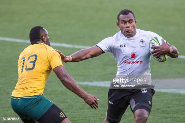 Leone Nakarawa of the Fijian Rugby Union Team pushes away Tevita Kuridrani of the Australian Wallabies Rugby Union Team during the International...