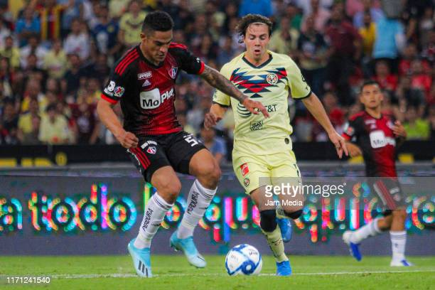 Leonel Lopez of America fights for the ball with Anderson Santamaria of Atlas during the 8th round match between Atlas and America as part of the...