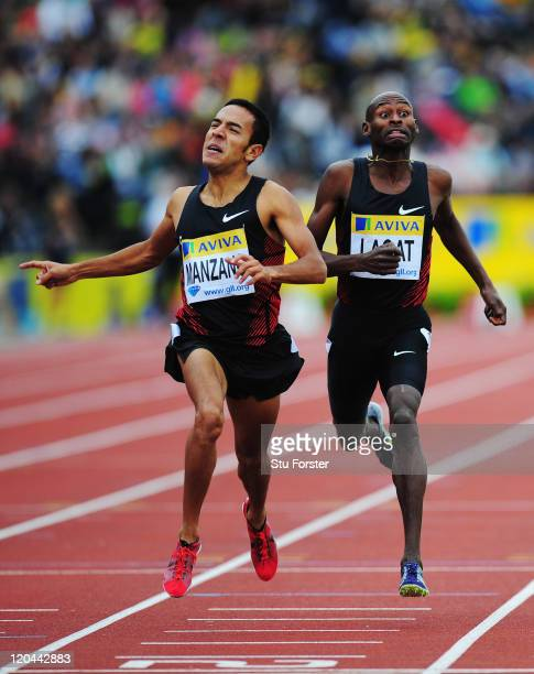 Leonel Manzano of the United States of America and Bernard Lagat of the United States of America compete in the Emsley Carr Mile during the Aviva...