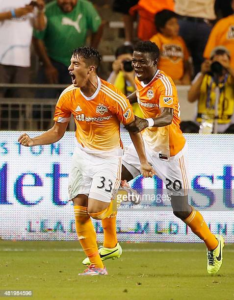 Leonel Miranda and Rasheed Olabiyi of the Houston Dynamo celebrate after Miranda scored a second half goal against the Los Angeles Galaxy at BBVA...