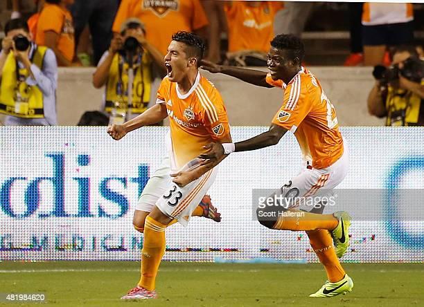Leonel Miranda and Rasheed Olabiyi of the Houston Dynamo celebrate after Miranda scored a second half goal against the Los Angeles Galaxy at BBVA...
