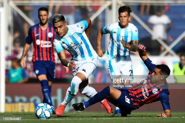Leonel Miranda of Racing Club fights for the ball with Diego Rodriguez of San Lorenzo during a match between San Lorenzo and Racing Club as part of...