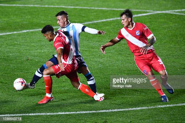 Leonel Miranda of Racing Club fights for the ball with Marcelo Cabrera of Argentinos Juniors during a match between Argentinos Juniors and Racing...