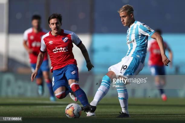 Leonel Miranda of Racing Club passes the ball during a group F match of Copa CONMEBOL Libertadores 2020 between Racing and Nacional at Juan Domingo...