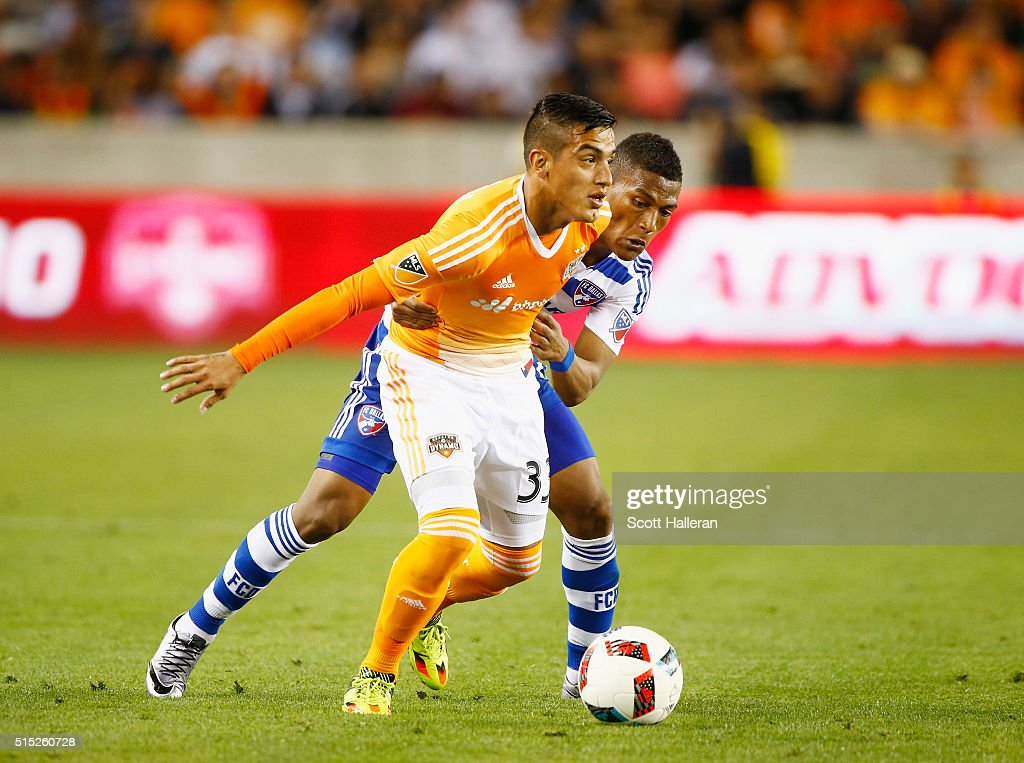 Leonel Miranda #33 of the Houston Dynamo battles for the ball with Carlos Gruezo #7 of FC Dallas during their game at BBVA Compass Stadium on March 12, 2016 in Houston, Texas.