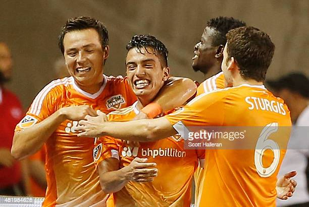 Leonel Miranda of the Houston Dynamo is greeted by his teammates after Miranda scored a second half goal against the Los Angeles Galaxy at BBVA...