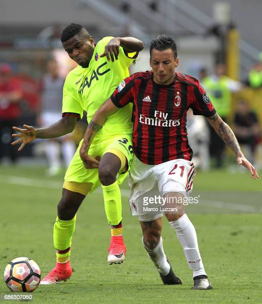 Leonel Vangioni of AC Milan competes for the ball with Orji Okwonkwo of Bologna FC during the Serie A match between AC Milan and Bologna FC at Stadio...