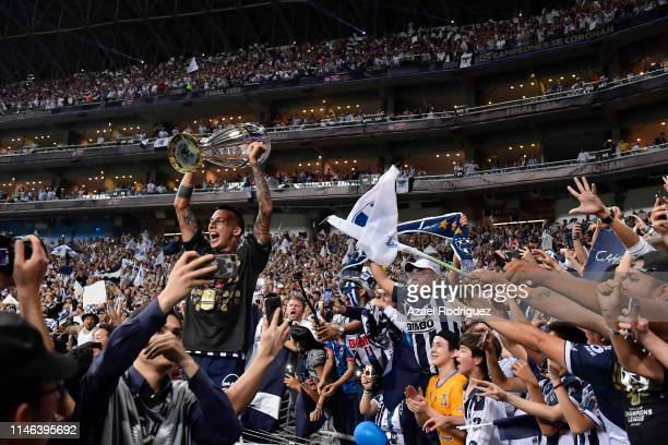 Leonel Vangioni of Monterrey celebrates with fans after winning the final second leg match between Monterrey and Tigres UANL as part of the CONCACAF...