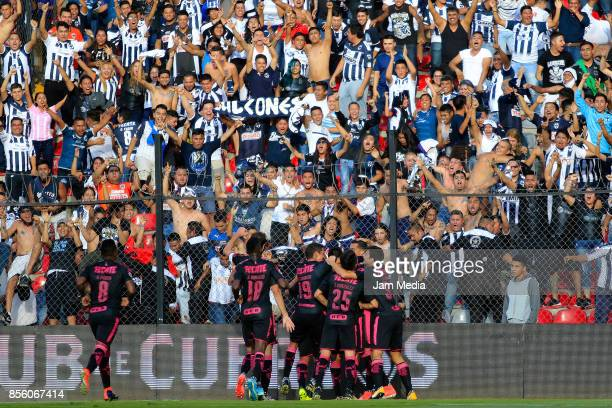 Leonel Vangioni of Monterrey celebrates with teammates after scoring the second goal of his team during the 12th round match between Queretaro and...