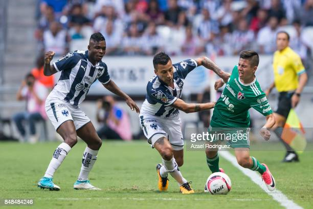 Leonel Vangioni of Monterrey fights for the ball with Bryan Garnica of Atlas during the 9th round match between Monterrey and Atlas as part of the...