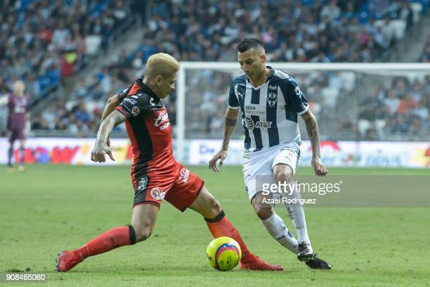 Leonel Vangioni of Monterrey fights for the ball with Juan Iturbe of Tijuana during the third round match between Monterrey and Tijuana as part of...