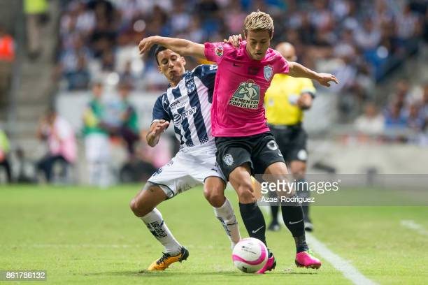 Leonel Vangioni of Monterrey fights for the ball with Keisuke Honda of Pachuca during the 13th round match between Monterrey and Pachuca as part of...