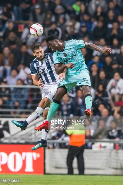 Leonel Vangioni of Monterrey heads the ball with Djaniny Tavares of Santos during the 11th round match between Monterrey and Santos Laguna as part of...