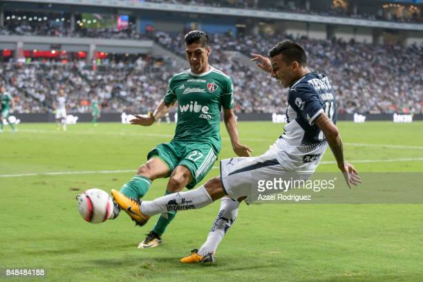 Leonel Vangioni of Monterrey kicks the ball over Jose Maduena of Atlas during the 9th round match between Monterrey and Atlas as part of the Torneo...