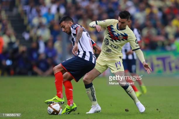 Leonel Vangioni of Monterrey struggles for the ball against Nicolás Benedetti of America during the Final second leg match between America and...