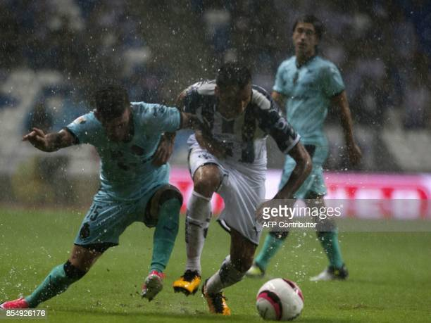 Leonel Vangioni of Monterrey vies for the ball with Brian Lozano of Santos during their Mexican Apertura 2017 tournament football match at the BBVA...