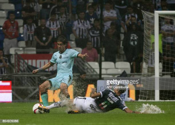 Leonel Vangioni of Monterrey vies for the ball with Jose Abella of Santos during their Mexican Apertura 2017 tournament football match at the BBVA...