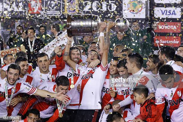 Leonel Vangioni of River Plate lifts the Copa Libertadores trophy after the final match between River Plate and Tigres UANL as part of Copa...