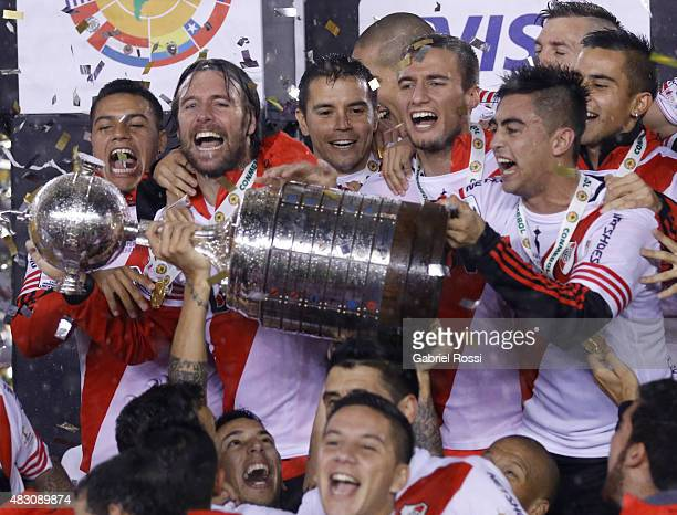Leonel Vangioni of River Plate lifts the trophy with his teammates after winning a final match between River Plate and Tigres UANL as part of Copa...